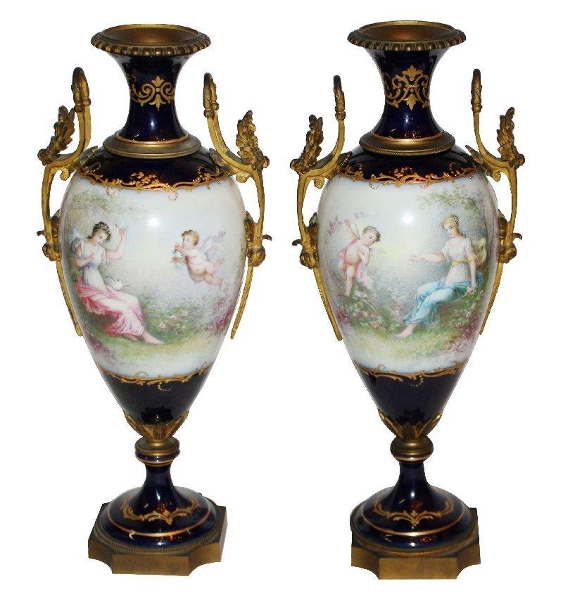 73: Pair of antique Sevres urns w/ bronze garland