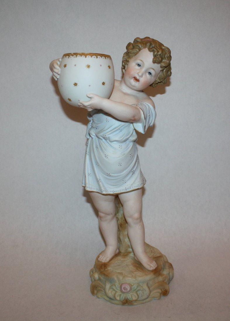 12: Bisque figurine of cherub with bowl