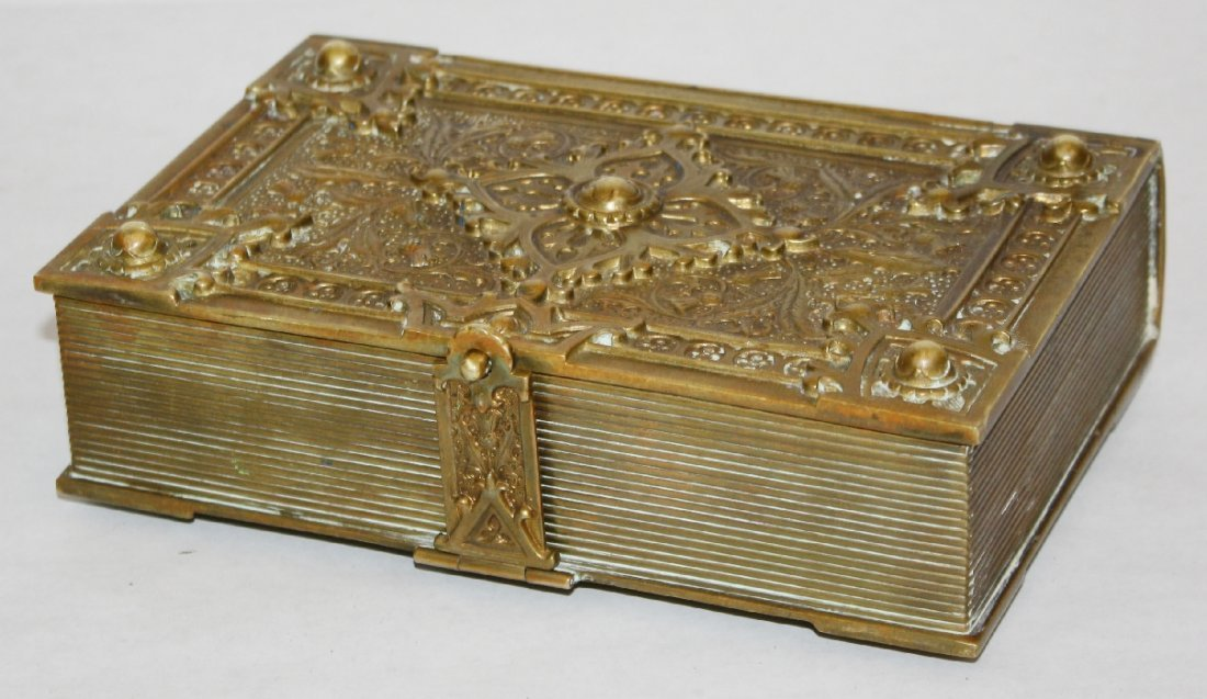 1: Hand worked bronze box in the form of a book