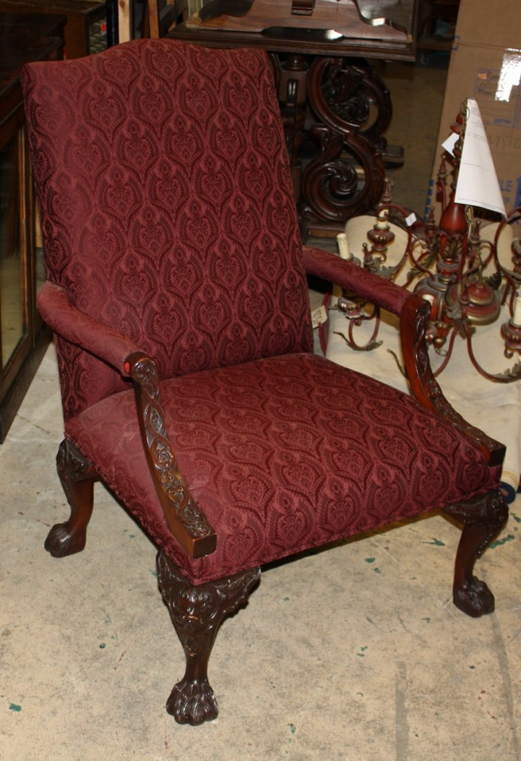 6: Carved mahogany armchair with paw feet