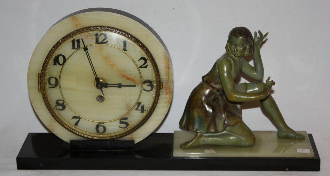 Vintage Art Deco clock with kneeling woman