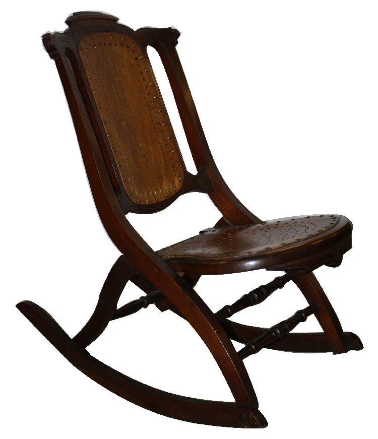 Carved folding rocking chair with brass studs