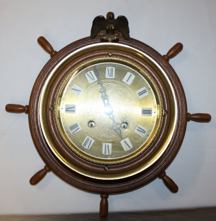 Ship's wheel wall clock with brass eagle focal