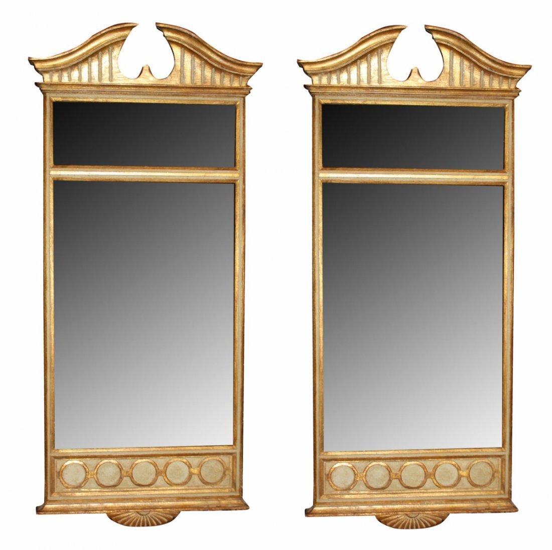 A pair of Italian gilt wood mirrors