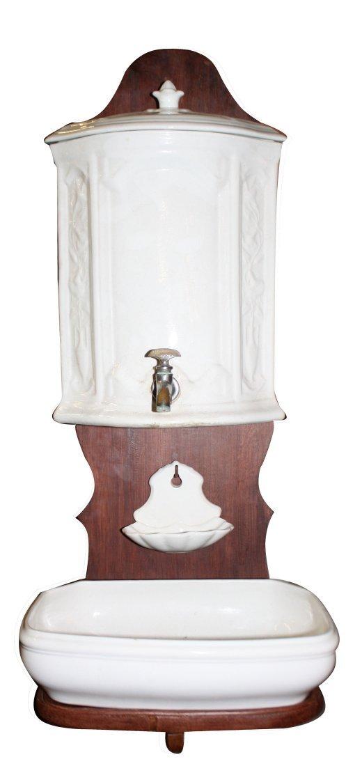 Dutch porcelain wall fountain mounted on board