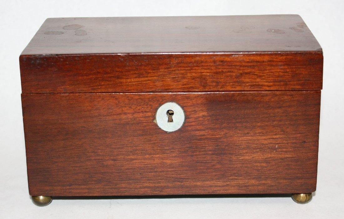 English mahogany tea caddy on rounded brass feet