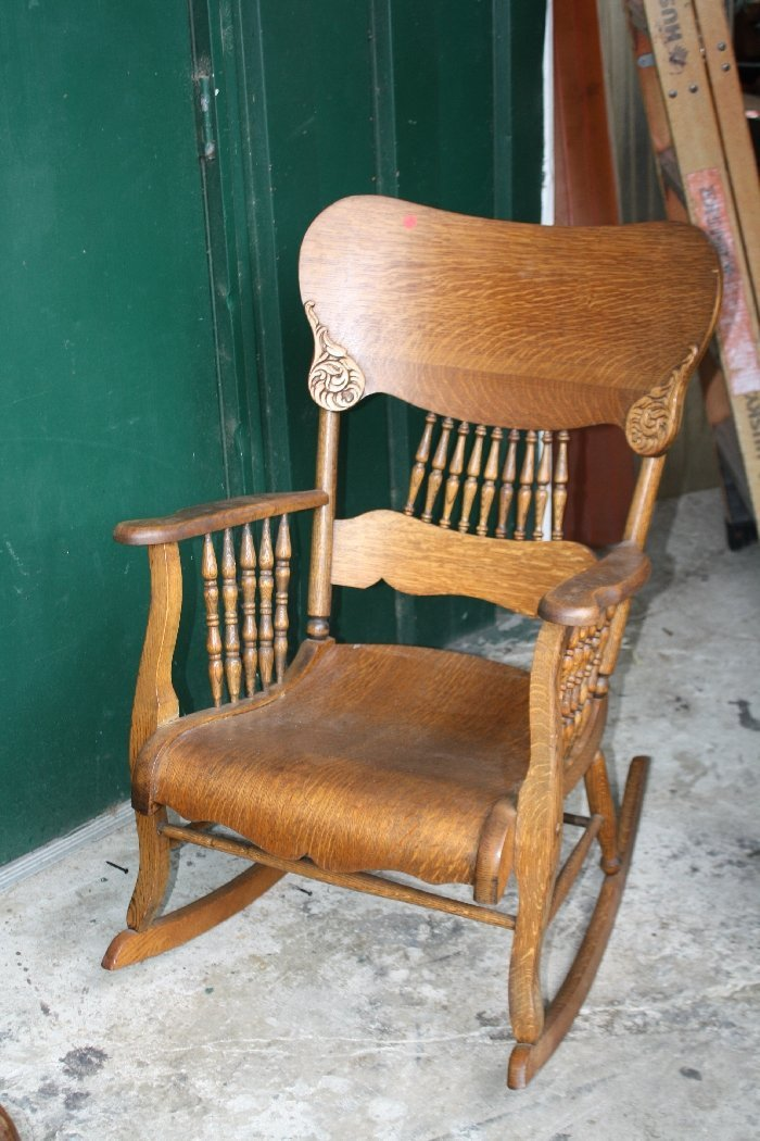 American press back carved oak rocking chair