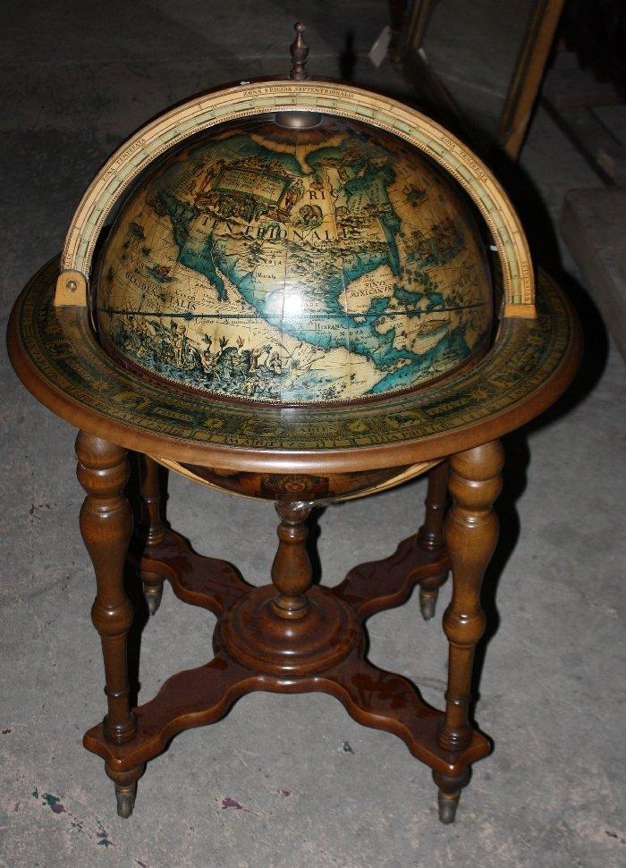 Vintage lift top terrestrial globe shaped bar on caster