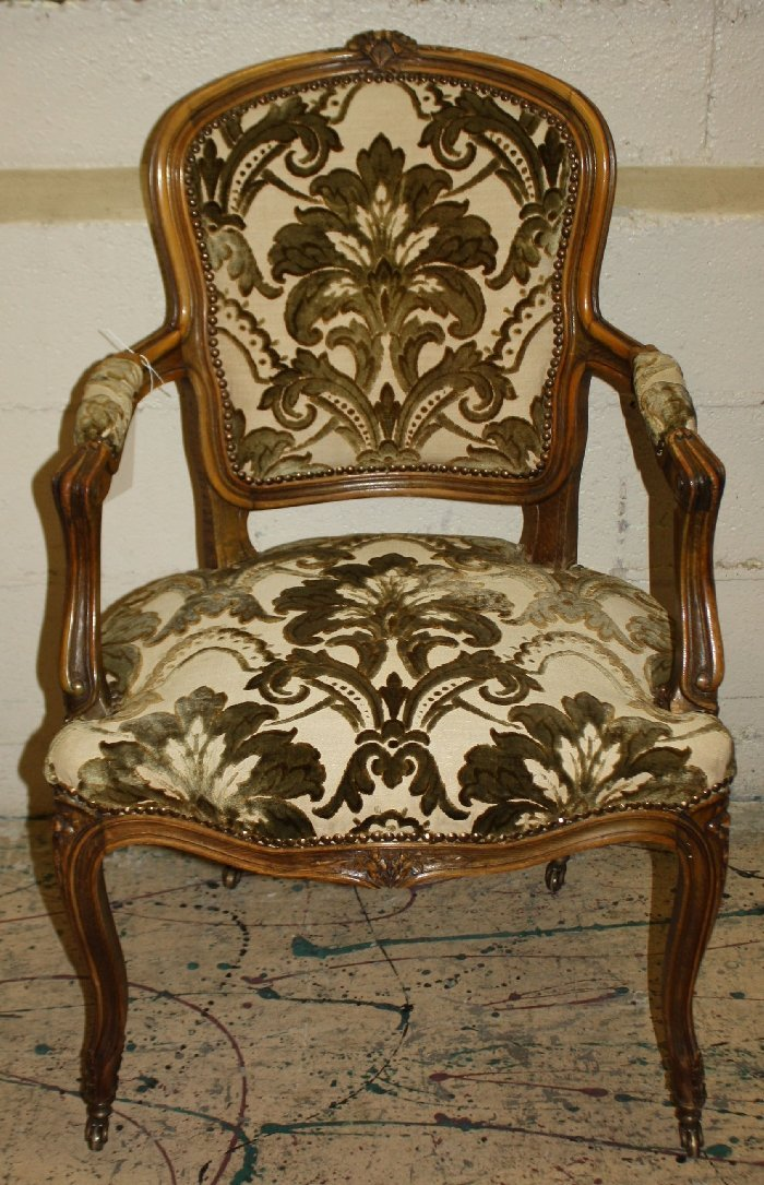 French Louis XV carved walnut armchair on casters
