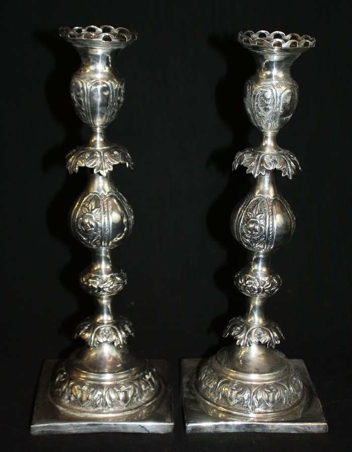A pair of Polish hand hammered .875 silver candlesticks