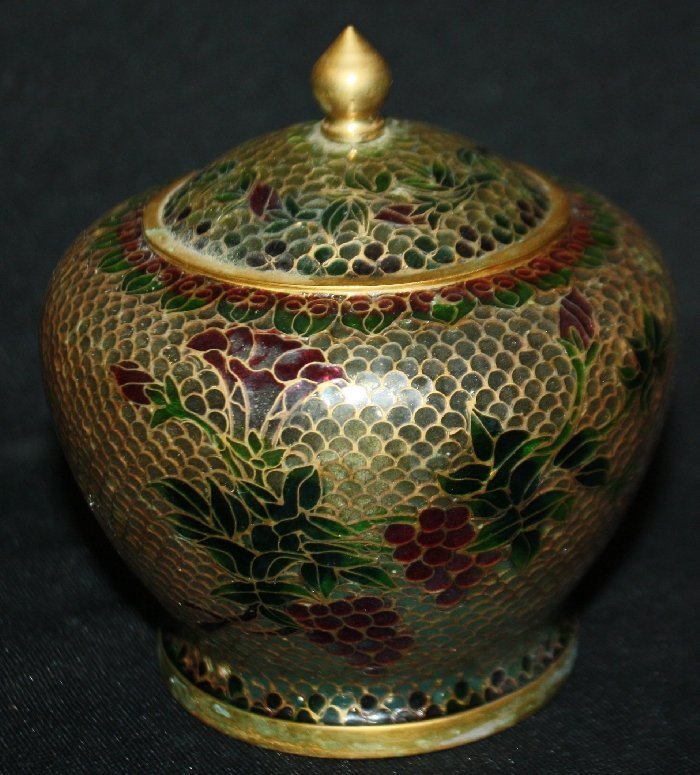 Plique a jour decorated lidded jar with red flowers