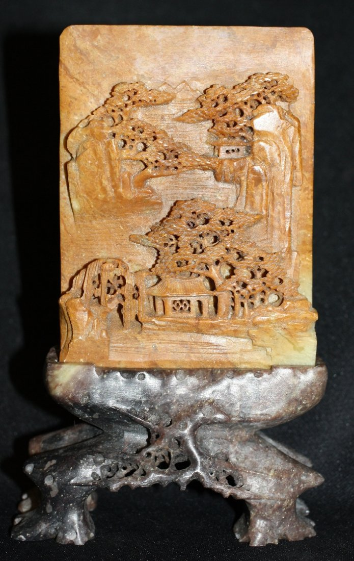 Soapstone carving of trees on wooden stand
