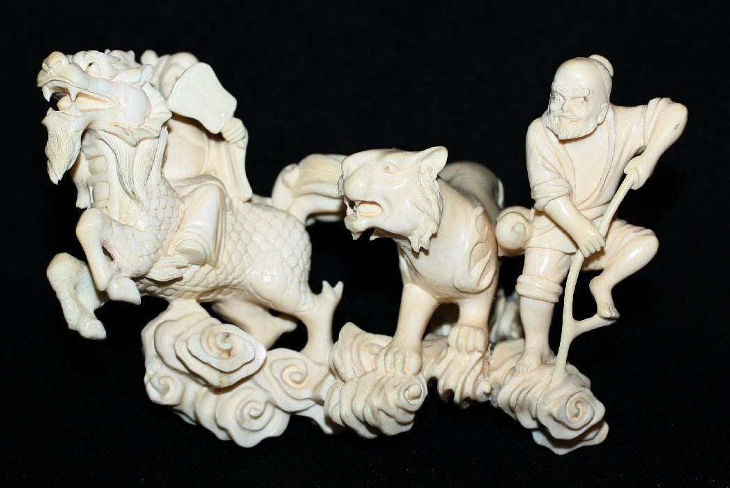 Small figural carved ivory statue with dragon & tiger