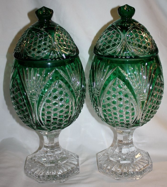 Pair of green cut to clear crystal lidded compotes