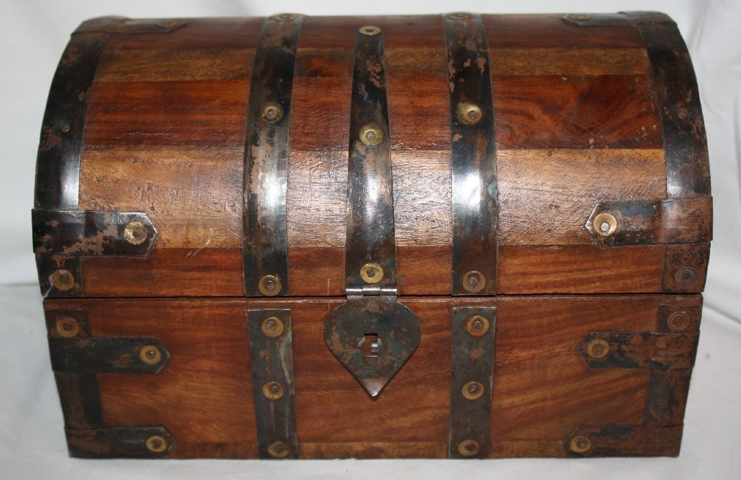 Dome top lidded trunk with brass accents