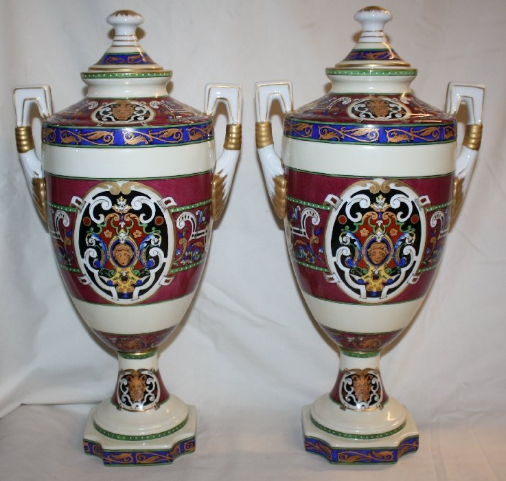 Pair of lidded porcelain urns with bacchus heads