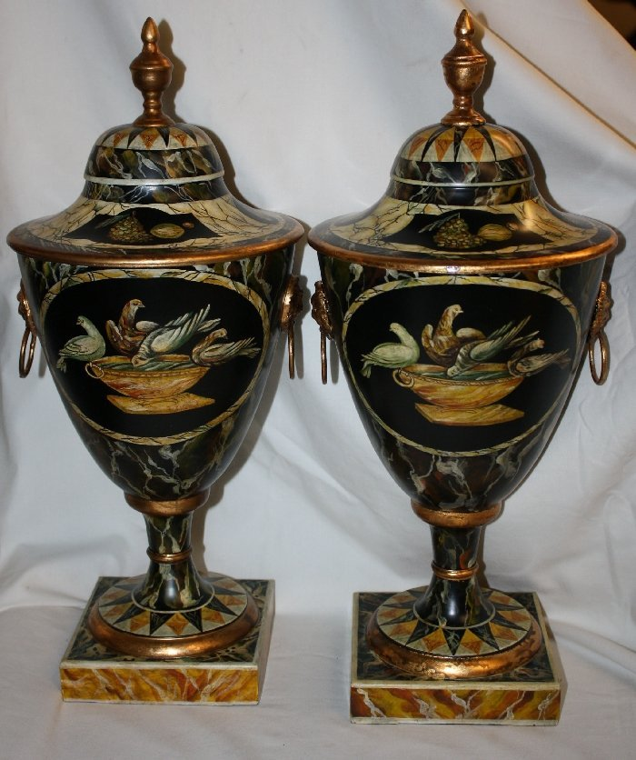 Pair of painted lidded urns with doves & lion rings