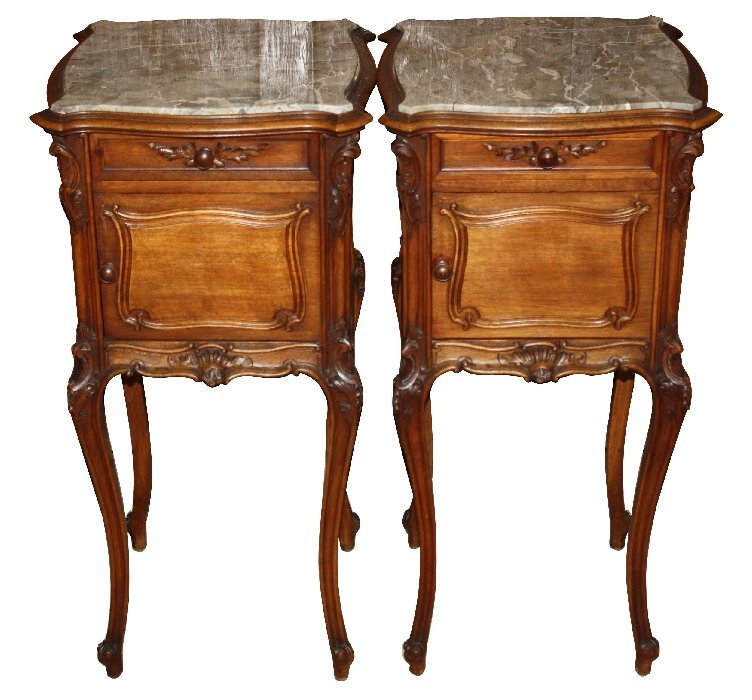 Pair of French Louis XV carved walnut chevets