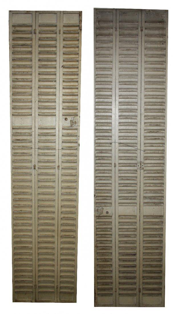 Pair of vintage metal shutters