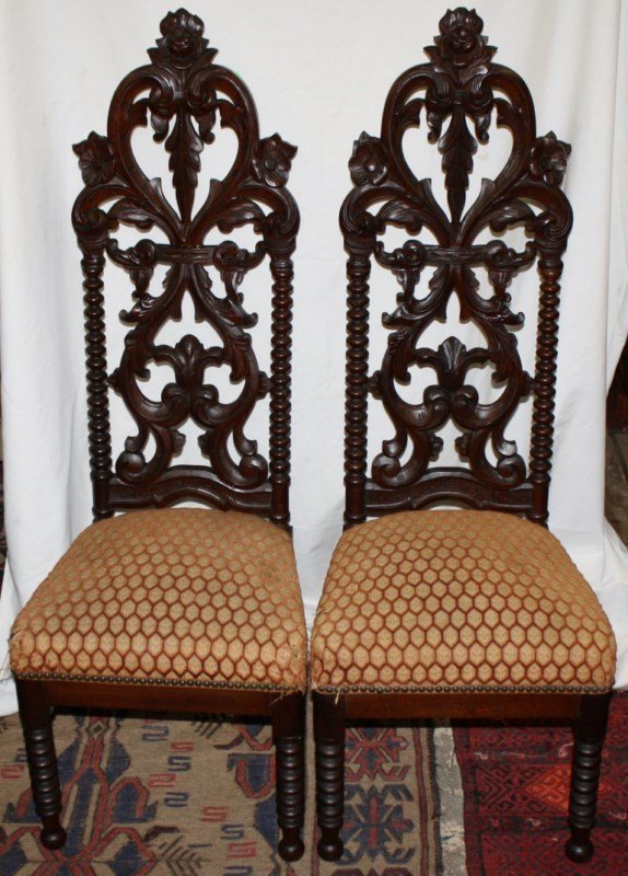 Pair of English heavily carved high back chairs