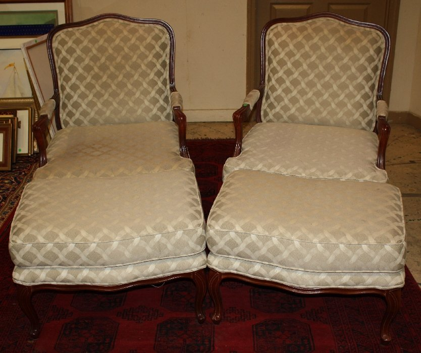 Pair of oversize upholstered armchairs with ottomans