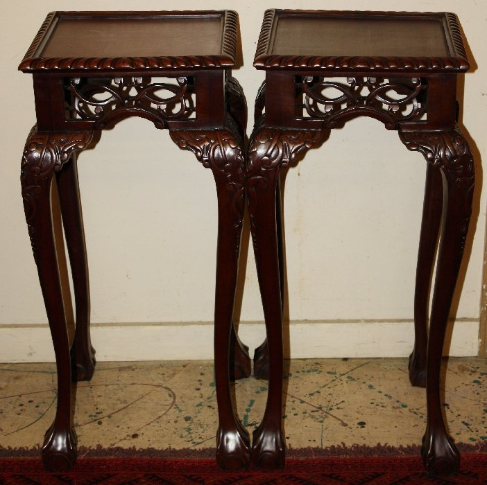 Pair of mahogany plant stands with ball & claw feet