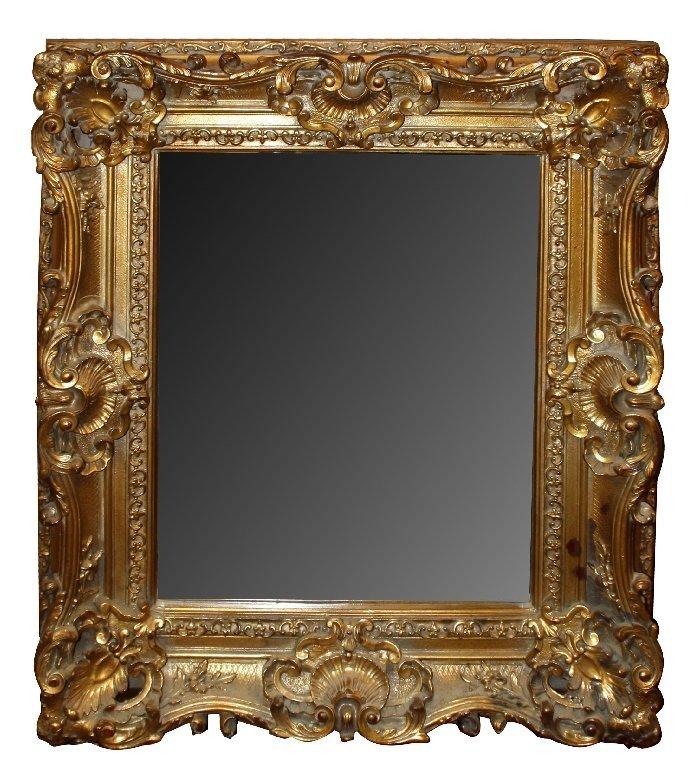 Ornate Rococo gilt framed beveled mirror