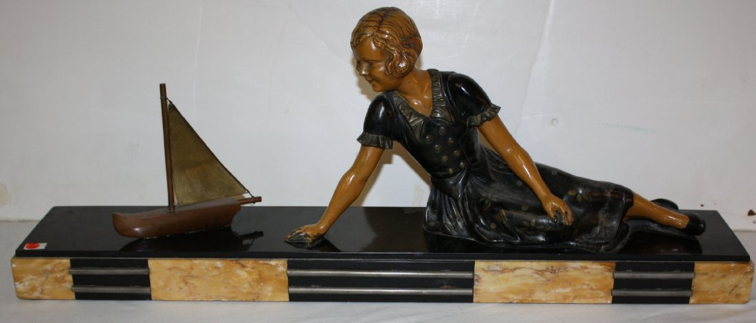French Art Deco statue depicting woman with sailboat