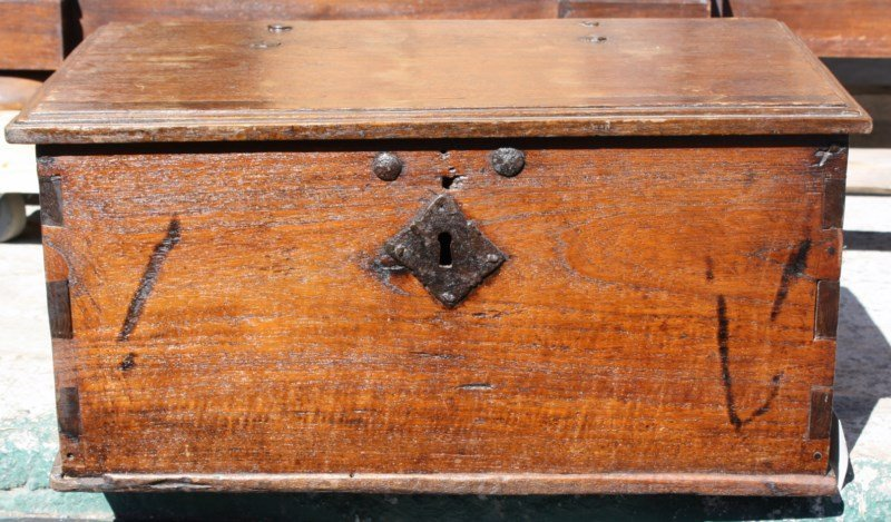 Antique wooden trunk with iron handles