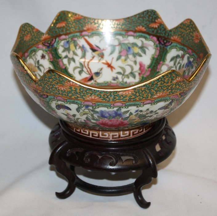 Chinese porcelain bowl on carved mahogany stand
