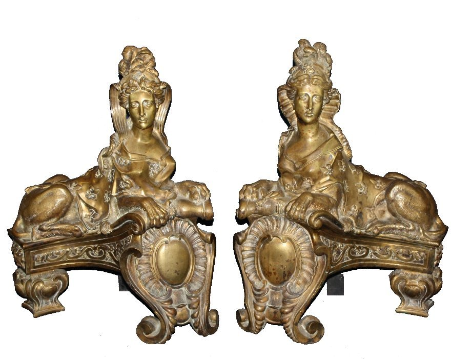 Pair of French gilt bronze chenets form of recumbent