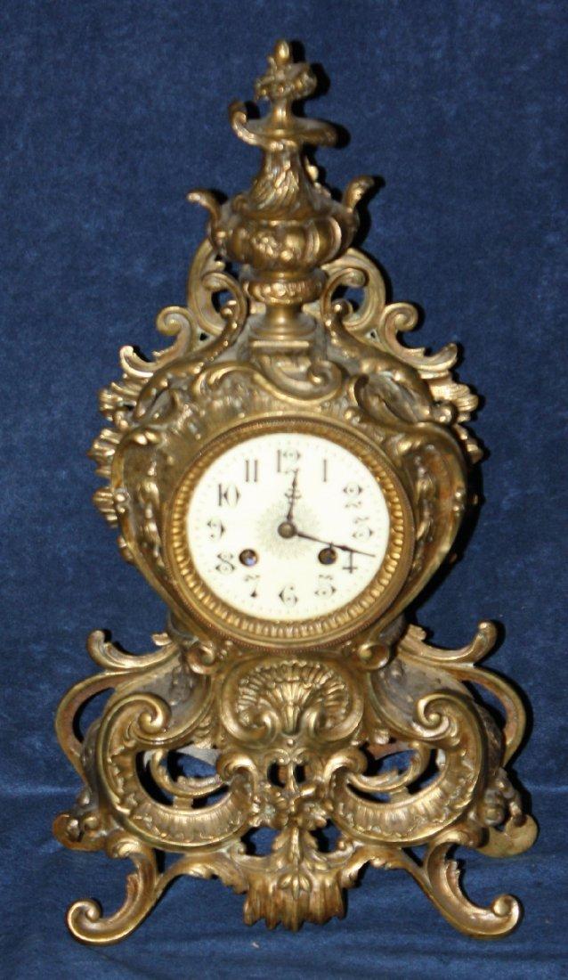 Rococo style bronze mantel clock
