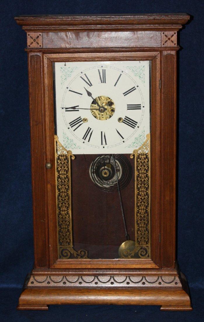 American Eastlake mantel clock in walnut case