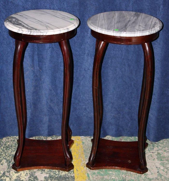 Pair of tiered round marble top pedestals