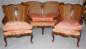 French Louis XV carved walnut  cane parlor set with pi