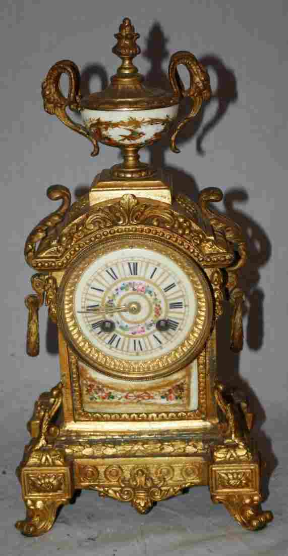 French Louis XVI gilt bronze clock. Signed L. Marti