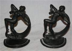Pair of iron bookends with dancing women