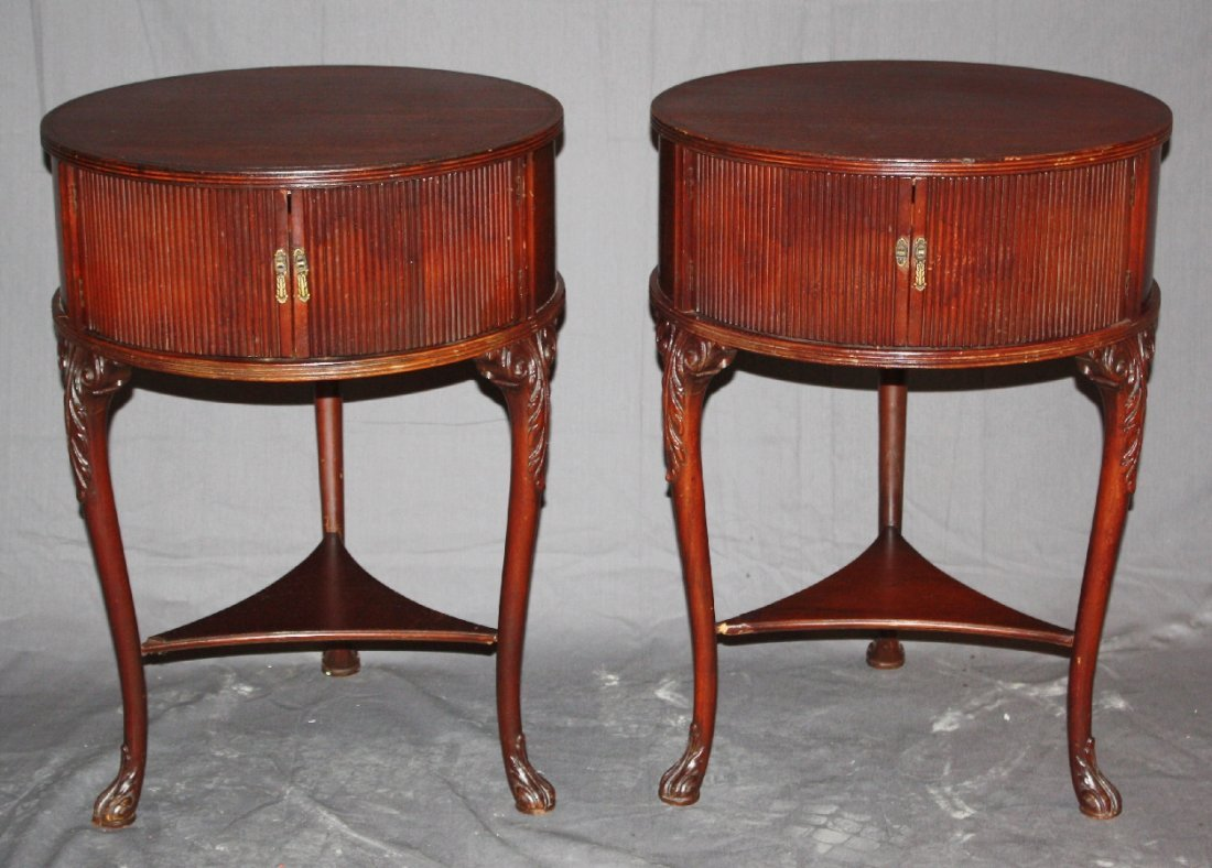 Pair of round mahogany side tables