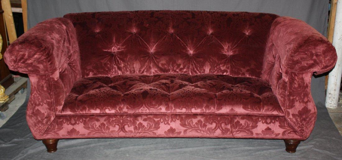 Curved back red velvet upholstered sofa