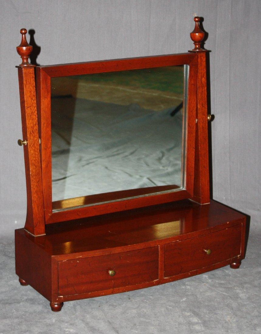 Mahogany vanity mirror with 2 drawers.