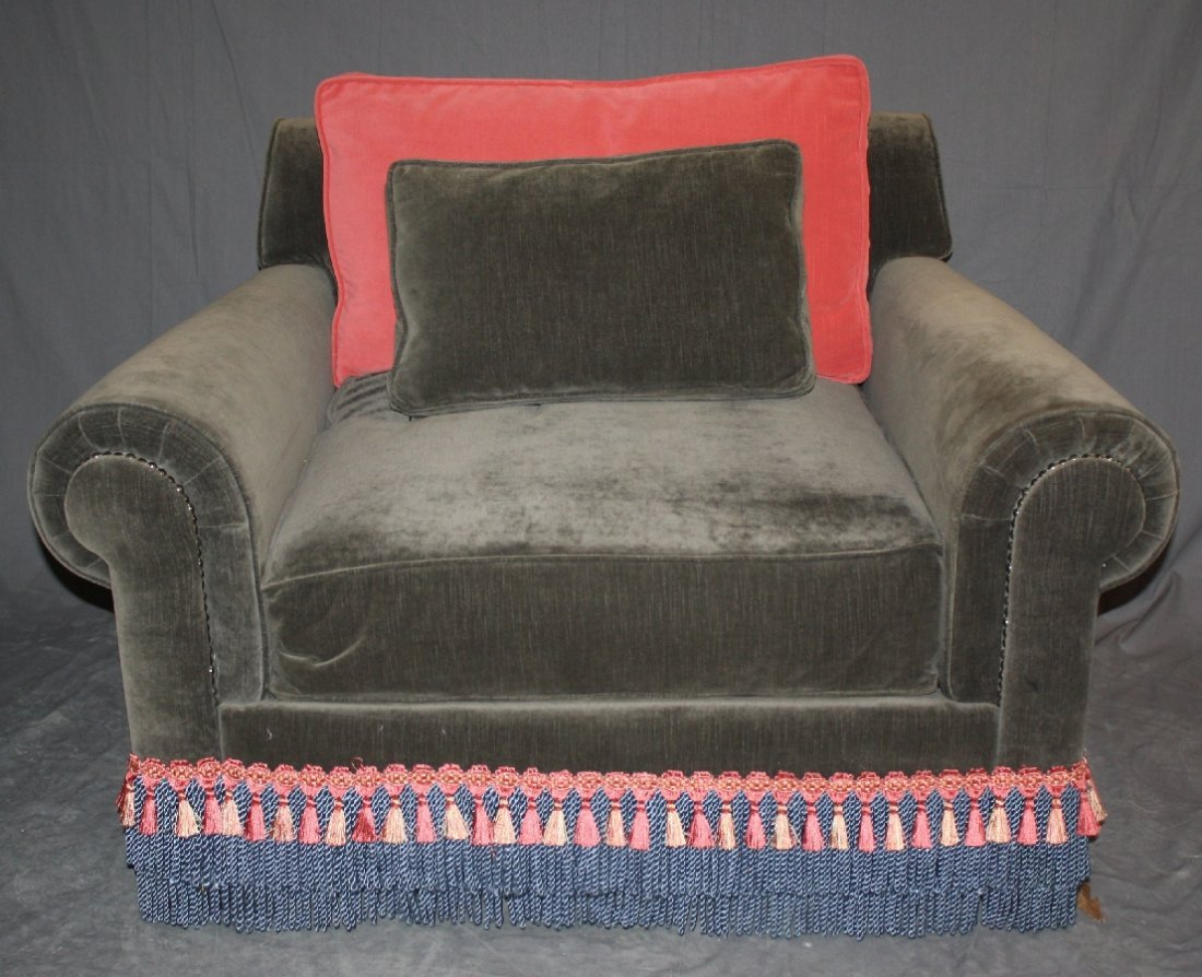 Velvet upholstered club chair with rolled arms & fringe