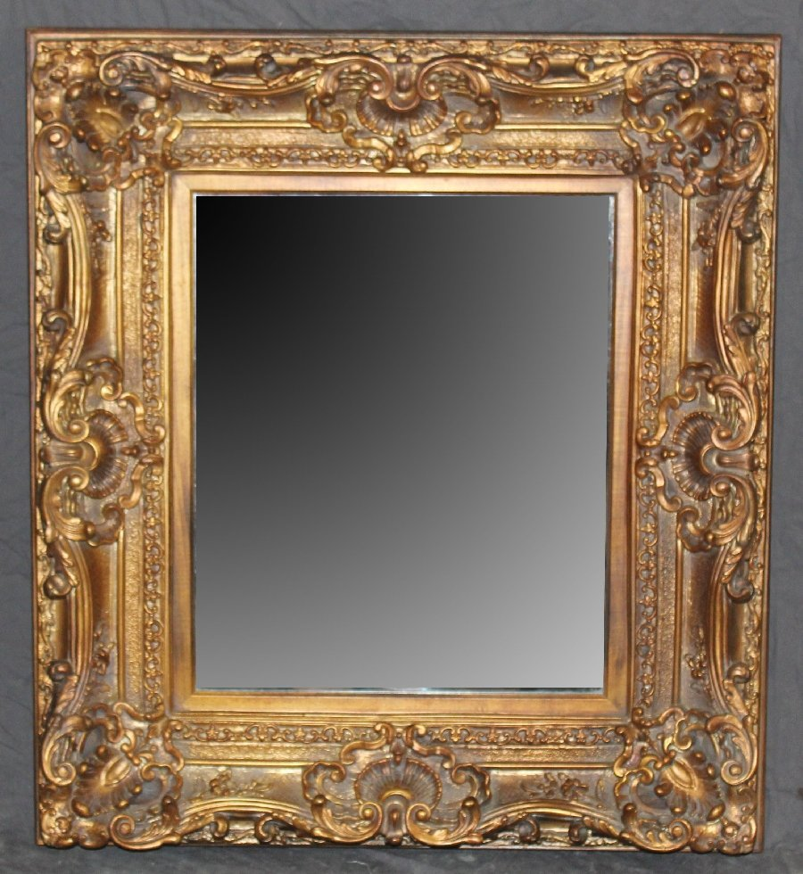 French Louis XV style gold painted wood framed mirror