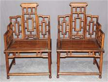 Pair of Chinese hardwood armchairs with lattice