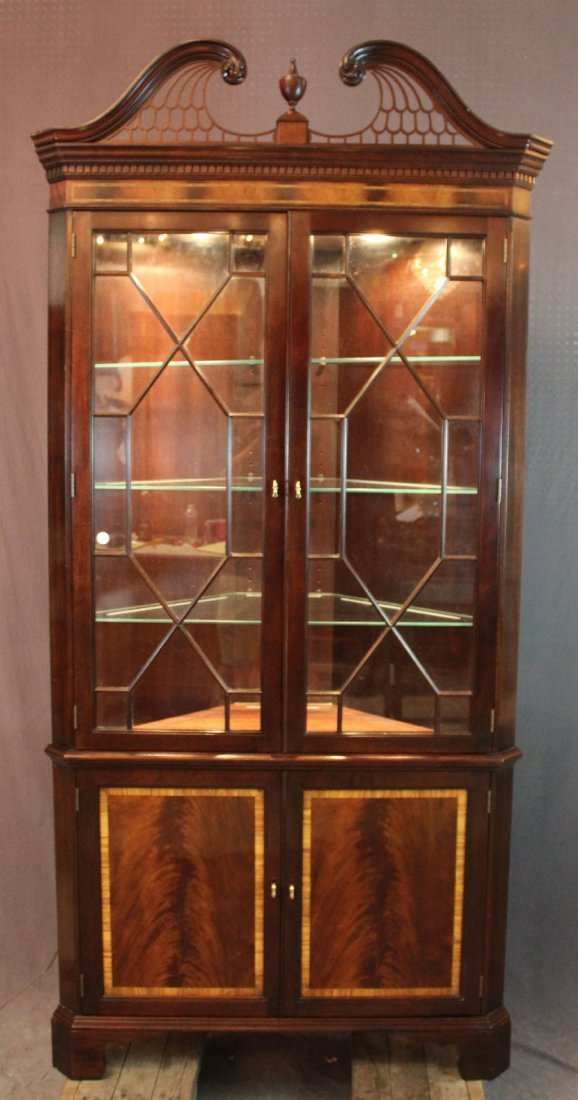 corner cabinet w/ fretwork open arch pediment