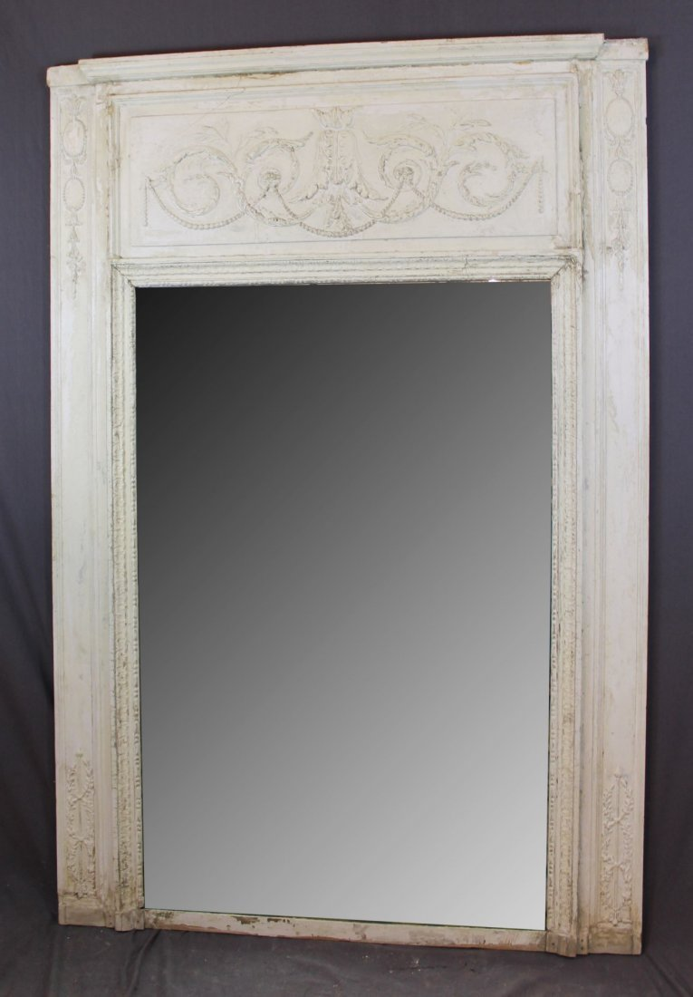 Antique French mirror with raised beaded garland