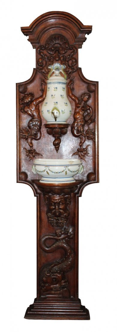 French porcelain lavabo mounted on relief carved stand