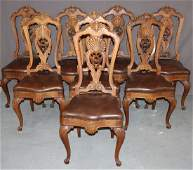 Set of 8 Italian carved walnut shell back chairs