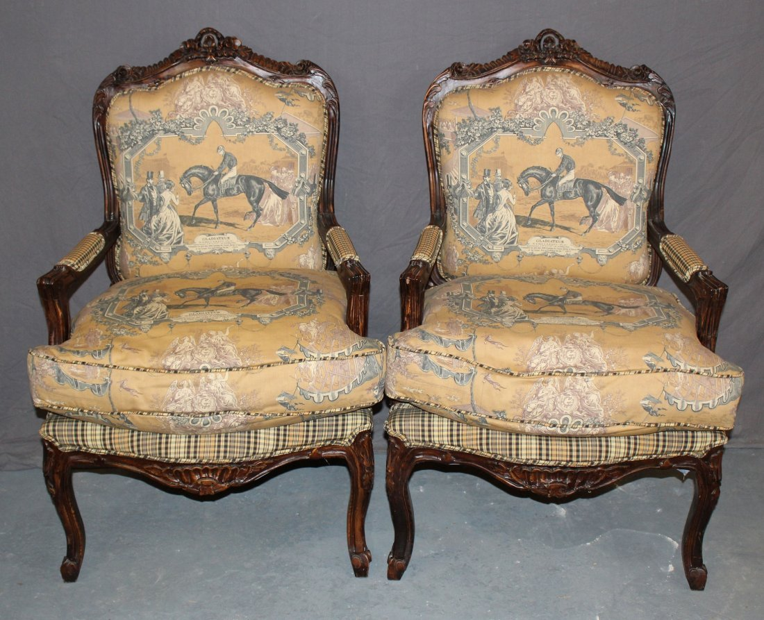 Pair of Louis XV style carved chairs with equestrian