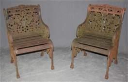 Pair American cast iron garden arm chairs