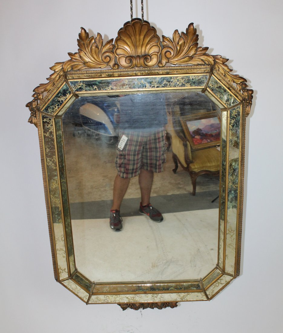 Venetian mirror with carved focal shell